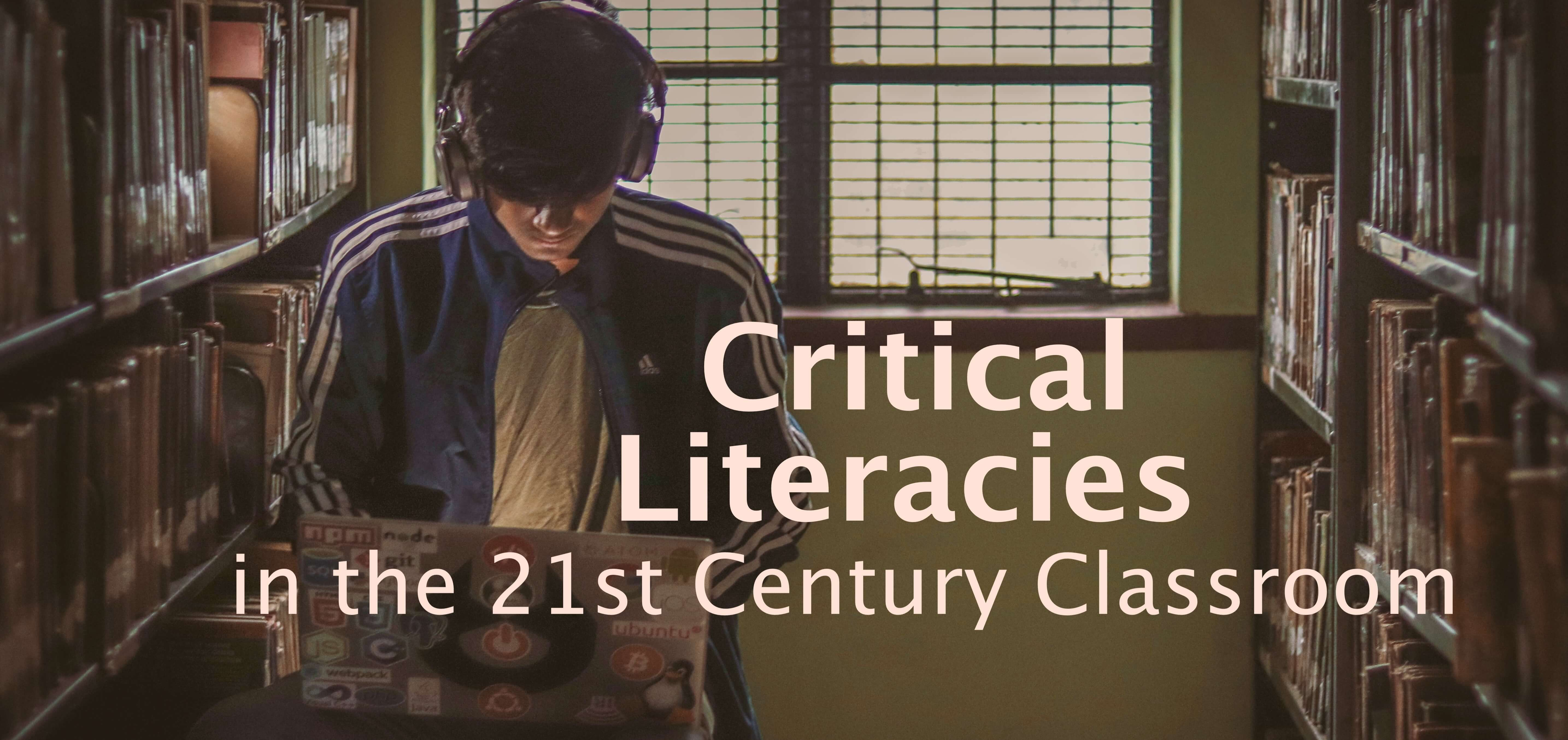 Young man wearing headphones sitting between library shelves looking down at laptop, with superimposed text: Critical Literacies in the 21st Century Classroom